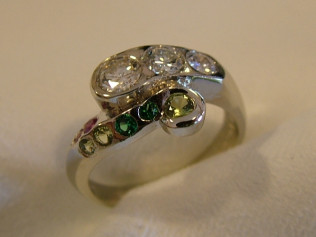 18K white gold handmade Mothers ring with a families diamonds from three generations, also emeralds, rubies, and peridots.